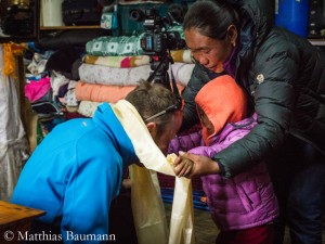 Baumann visiting the family of avalanche victim Chhiring Sherpa