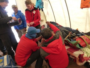 Doctors take care of injured climbers
