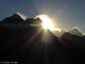 South side of Mount Everest (l.) at first light