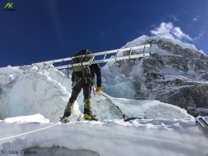 Txikon with a ladder on his back