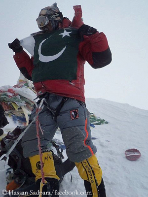 Hassan on the summit of Mount Everest in 2011