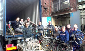 "Johannes (left, standing) and his team in front of a container used to ship bikes to Ghana. ""Bikes for Africa"" already shipped around 800 bikes to Ghana this year (Photo: Ronny Arnold)"
