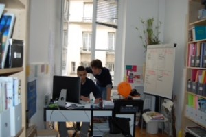 Samuel and a colleague at Coexister's office