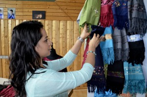 That's where Zohra comes in. She is selling colorful scarves in Germany that were stitched by Afghan women to send the revenues back to the Afghan families (Photo: Falk Steinborn)