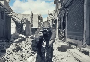 Firas capturing bombed streets on film (Photo: Firas Al-Shater)