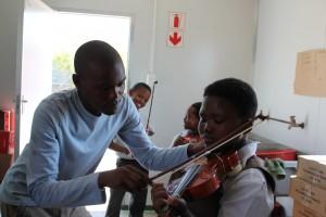 Siyathemba Nteta with violin student