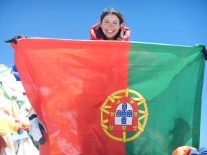 Maria on Mount Everest with a Portuguese flag