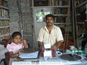 Scrap dealer Kishan Murthy with his little daughter at his shop