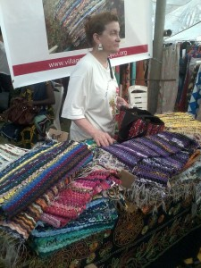 Ruth Zhumbul helps sell the rugs to customers abroad (Photo: N. Aghaji)