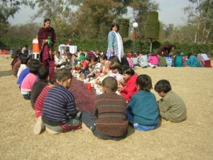 Andeisha with children in a park