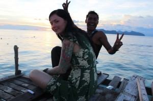 Felicity Finlayson relaxing with local staff on Pom Pom Island, Malaysia