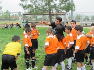 Mark with members of a YALLA soccer team