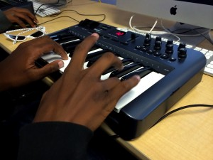 Student Emandre Winston uses the keyboard connected to the music production software at RYSE to work on his own track (Photo: A. Mendelson)
