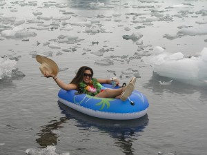 Climate Change Ambassador in bikini in melting ice, Alaska