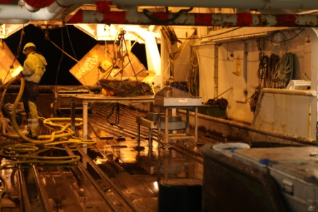 Cleaning  the trawl deck of the RV Helmer Hanssen