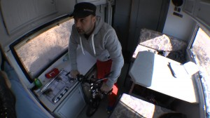 Michael Wigge on his Scooter in his RV during the train ride from the island Sylt to the coast