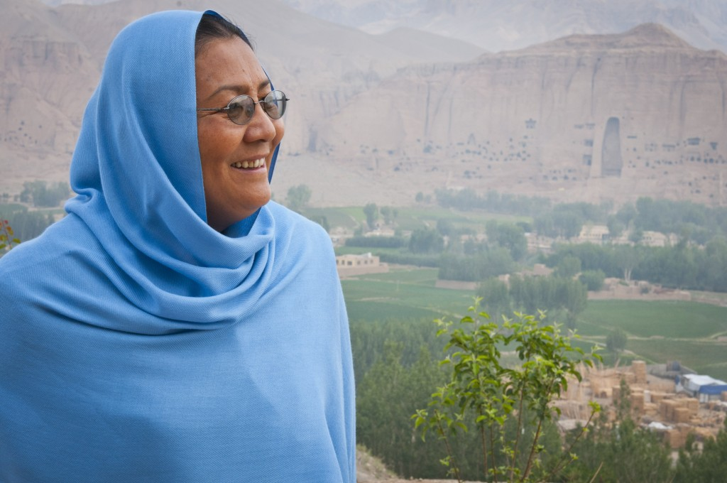 Bamyan Governor Dr. Habiba Sarabi stands on a patio overlooking the Bamyan river valley where the ancient standing Buddhas of Bamiyan statues used to reside in two giant insets, one of which can be seen here, June 18, 2012. Sarabi is the only female Afghan provincial governor in history.Since becoming a Governor, Dr Habiba Sarabi has efficiently governed Bamyan and used this platform to promote the rich cultural heritage of the province. © Ali Sher