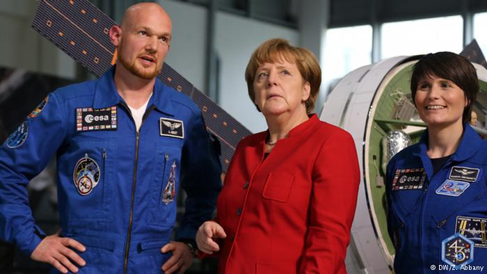 Cristoforetti (R) became a European astronaut in the same year as Alexander Gerst (L), pictured with Chancellor Merkel