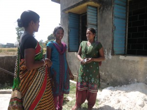(From left) Field Animator Shanti Devi, Gudiya, 15, of Bada Ulatu village and barefoot auditor Poonam Kumari, 20. Thanks to her presence of mind and fast action Poonam was able to save Gudiya from underage marriage. (Credit: Ajitha Menon\WFS)