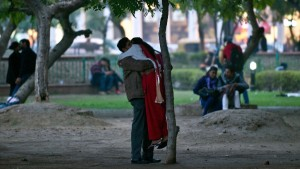 Indian couple hug and chat in a park during Valentine's Day in New Delhi on February 14, 2014. © AFP/Getty Images/P. Singh