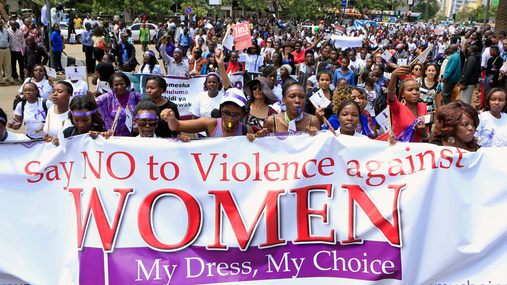 Women take part in a protest along a main street in the Kenyan capital of Nairobi November 17, 2014. The demonstrators were demanding justice for a woman who was attacked and stripped recently in Nairobi by men who claimed that she was dressed indecently.