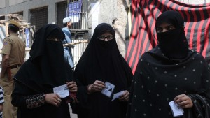 Muslim women on their way to a polling station in Jama Masjid locality for casting their votes for the  parliamentary election -2014 in New Delhi. © UNI