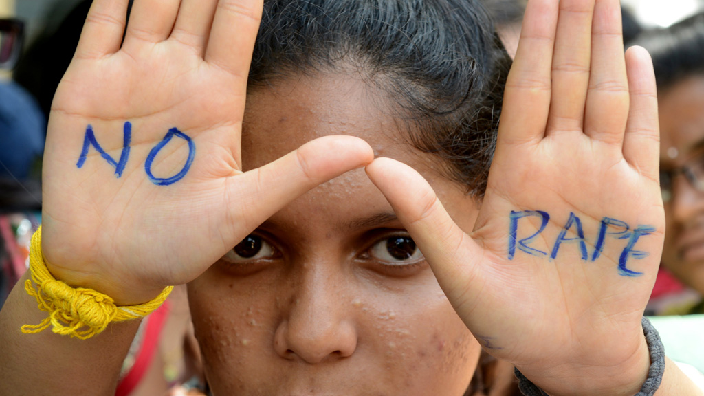 Indian students of Saint Joseph Degree college participate in an anti-rape protest in Hyderabad on September 13, 2013. (© Getty Images/N. Seelam)